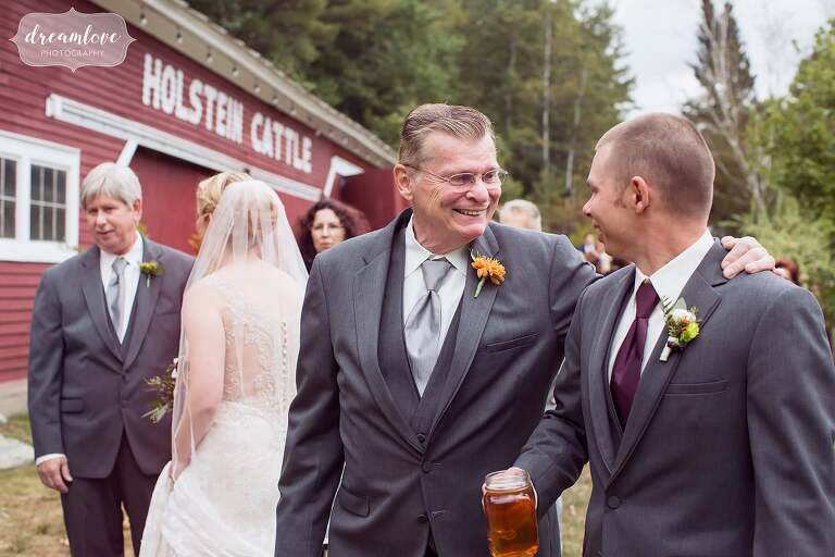 Happy candid photography of wedding guests at the Bishop Farm venue in Lisbon, NH.