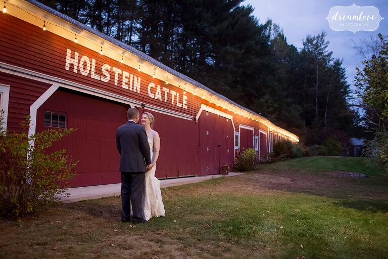 A nighttime photo of the bride and groom at dusk at the Bishop Farm.