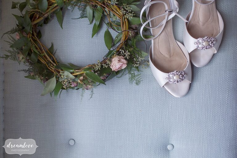 A flower crown sits next to a pair of wedding shoes at the Crane Estate.