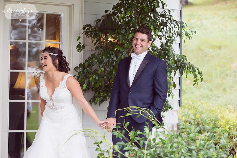 Emotional photo of the bride and groom laughing after first look in MA.