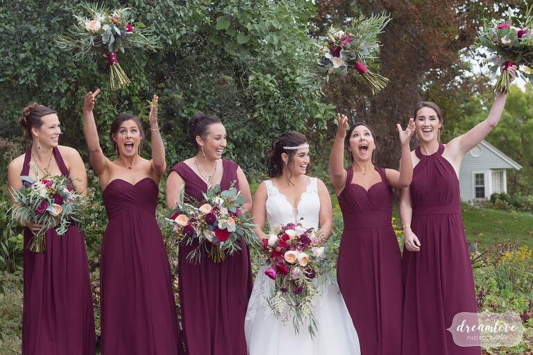 Hilarious photo of the bridesmaids who threw their flowers up into the air at the Crane Estate.