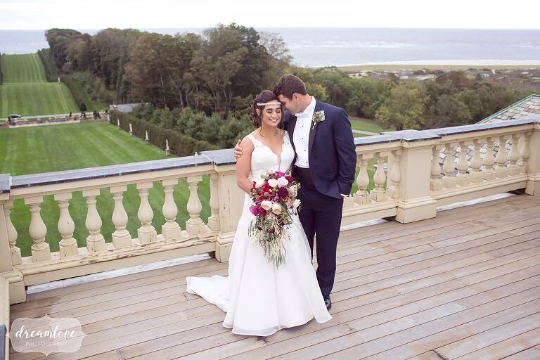 The bride and groom have a romantic moment at the rooftop of the Crane Estate, a storybook wedding venue overlooking the ocean just north of Boston.