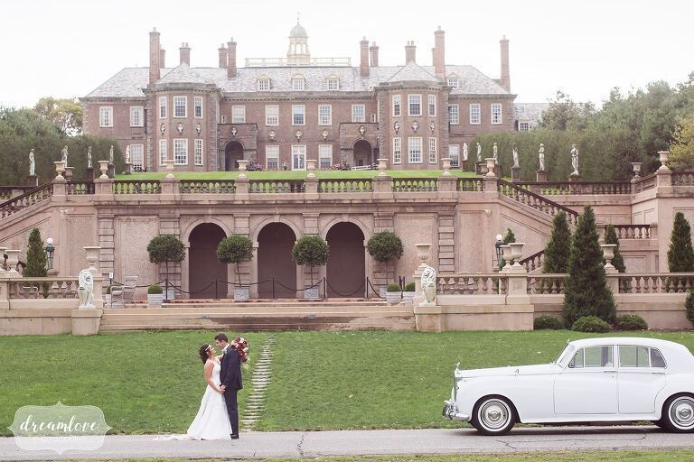 The bride and groom are pictured next to their Rolls Royce and in front of the epic Crane Estate mansion on Castle Hill. This wedding venue is a storybook setting for a coastal wedding!