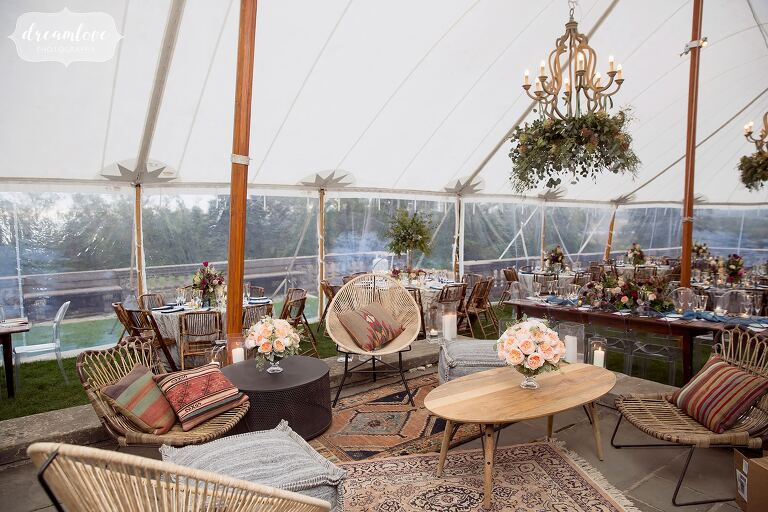 A beautiful midcentury modern lounge is created at the Crane Estate for the wedding reception under the tent.
