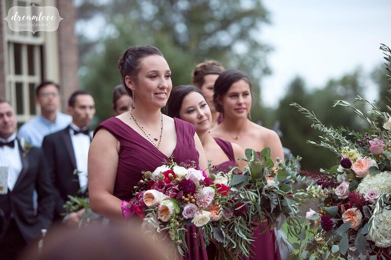 Bridesmaids wear merlow dresses at this terrace ceremony at the Crane Estate.
