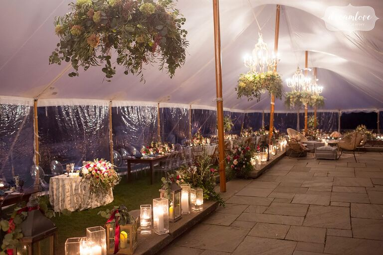 This storybook wedding venue is filled with candles and flowers at the Crane Estate.