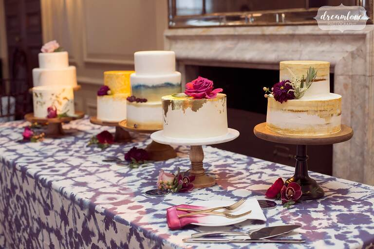 Artistic wedding cakes by Jenny's Wedding Cakes with gold leaf, watercolor, and flowers.
