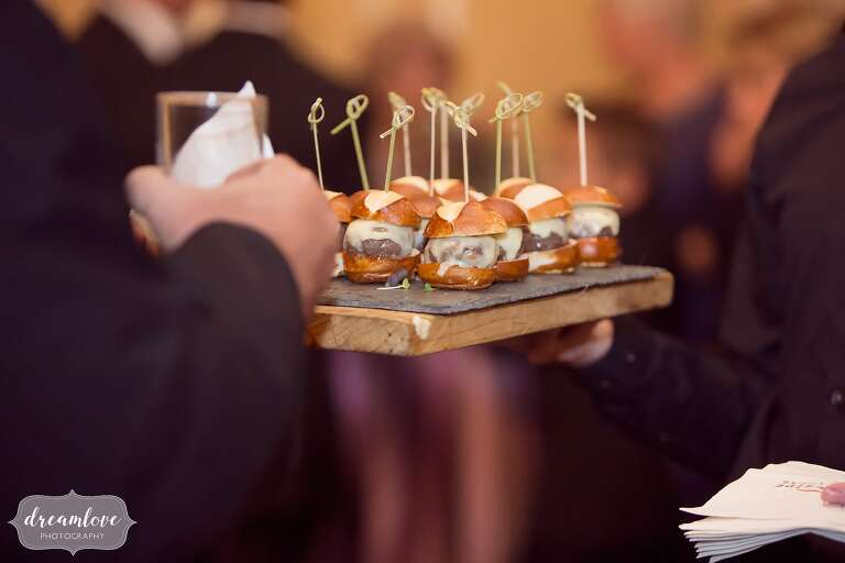 Guests enjoy sliders at the Crane Estate, catered by Fireside.