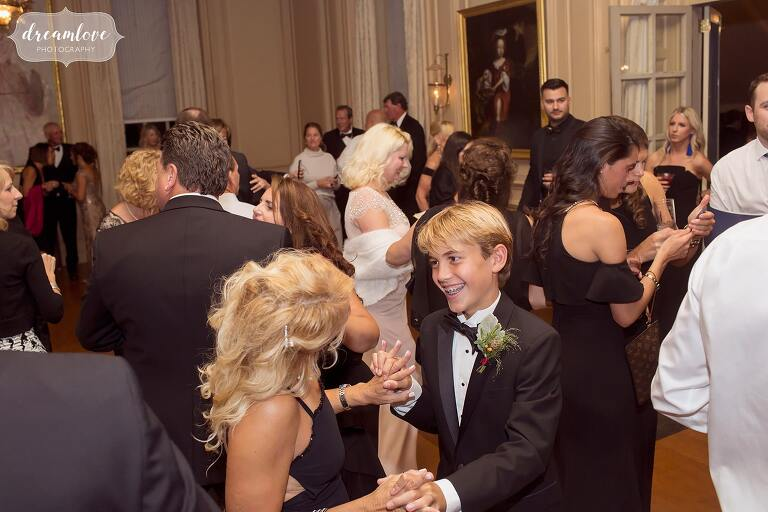 Guests dance in the ballroom at the Crane Estate.