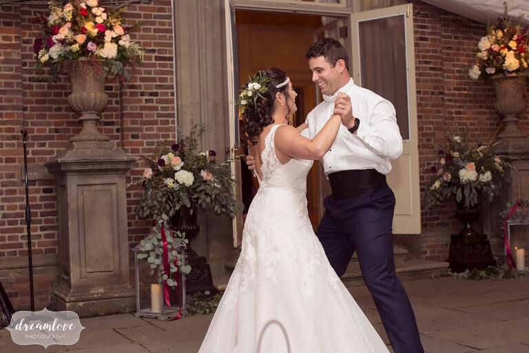 The bride and groom have their first dance at the Crane Estate on the north shore of MA.