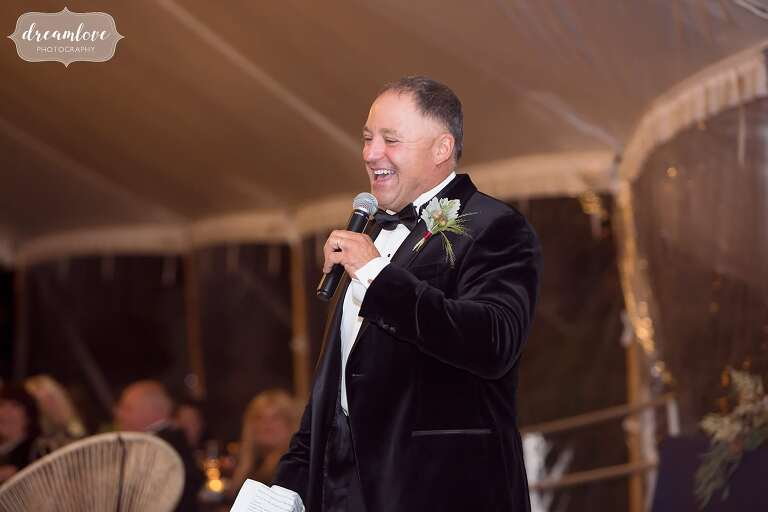 The father of the bride gives a toast under the reception tent at the Crane Estate.