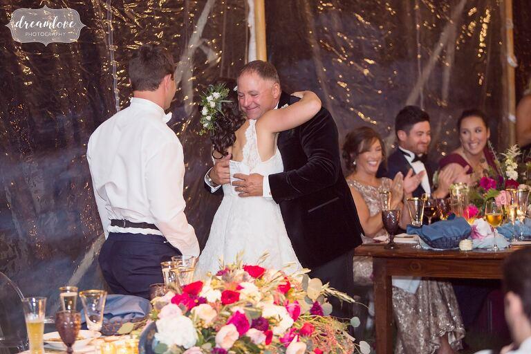 The bride hugs her dad at the Crane Estate reception.