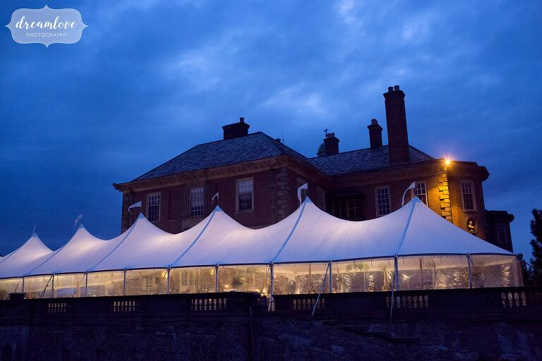 This storybook wedding venue has a sailcloth tent for the reception, beautiful blue at twilight.
