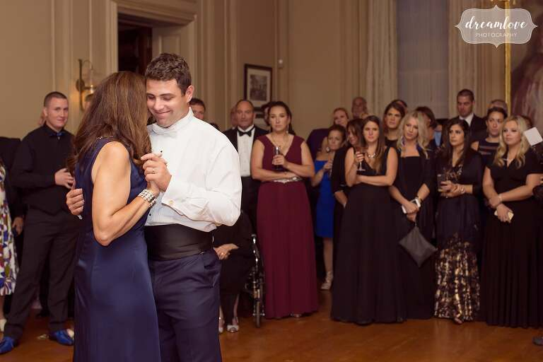 The groom dances with his mother at the Crane Estate.