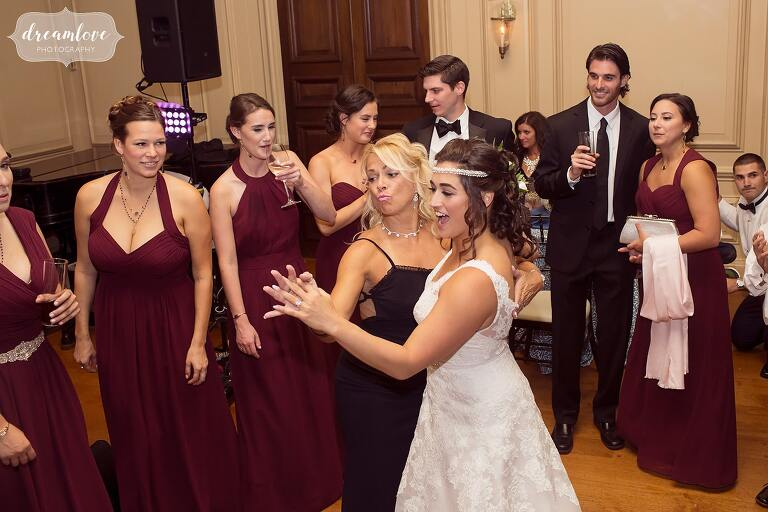 The bride dances with guests at the Crane Estate ballroom.