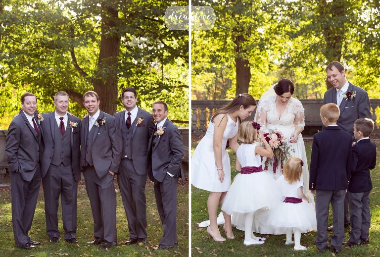 Wedding party poses for outdoor photos at the Larz Anderson Auto Museum in Boston.