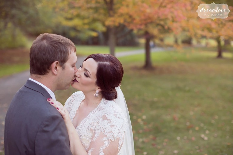 Romantic photo of the bride almost kissing the groom before their October wedding in Boston at Larz Anderson.