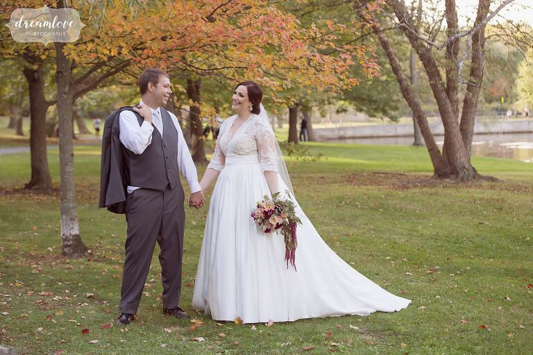 Natural wedding photography of the bride and groom with fall foliage in Boston, MA.