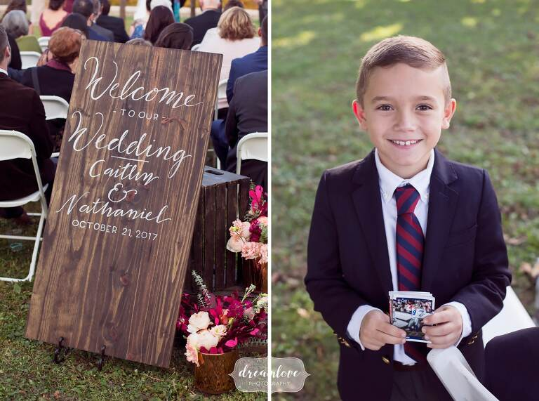 Adorable portrait of the ring bearer before an outdoor wedding ceremony with Boston skyline backdrop.