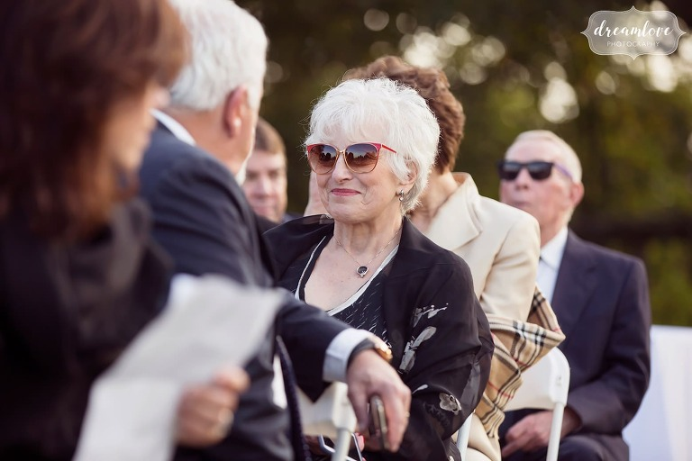 Candid pics of wedding guests before the outdoor ceremony begins on hilltop at Larz Anderson Auto Museum.