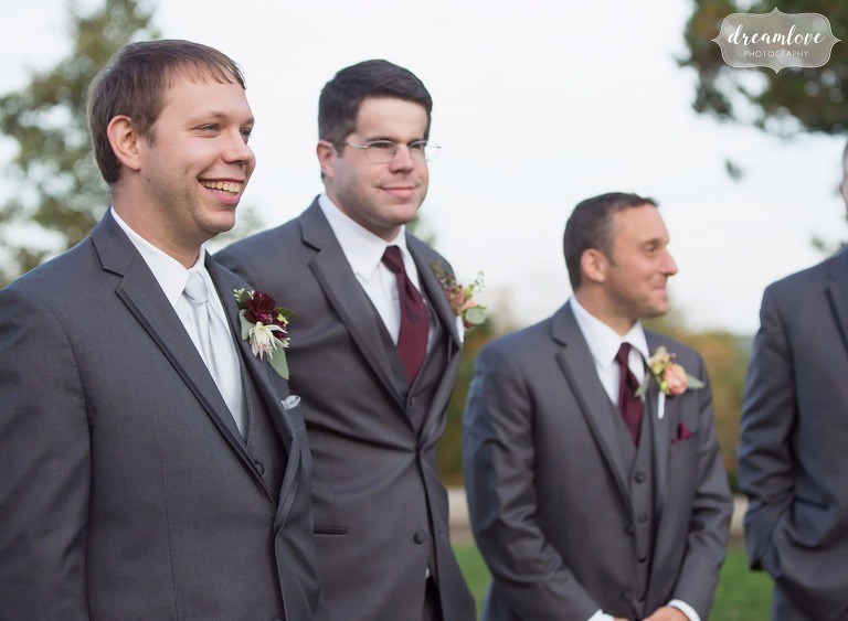 The groom watches as the bride enters the ceremony during this rustic outdoor wedding at Larz Anderson.