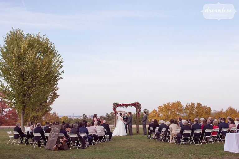 The Boston skyline is a beautiful backdrop at this Larz Anderson Auto Museum wedding in October.