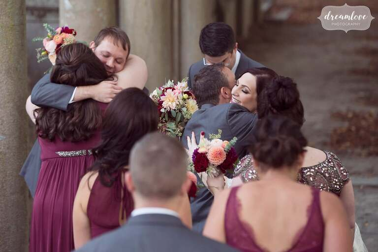 Documentary moments of guests congratulating newlyweds in Boston.