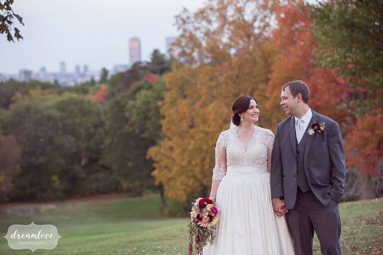 This outdoor wedding venue in Boston is at the Larz Anderson Park and has a view of the skyline and outdoor ceremony space.