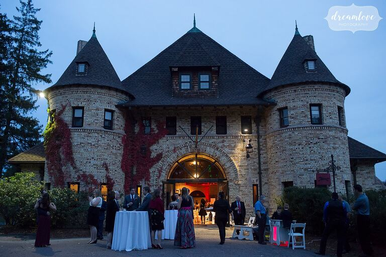 Guests enjoy the cocktail hour and arcade games at Larz Anderson chateau.