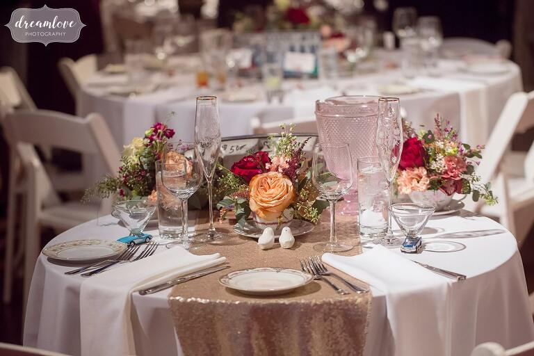 Sparkly gold table runners add flair to this antique car themed wedding in Boston.