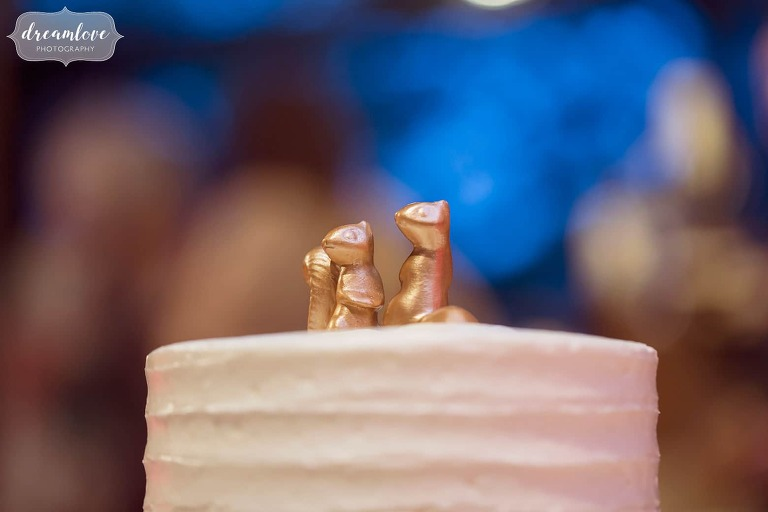 Golden squirrel cake toppers at this quirky Boston wedding.