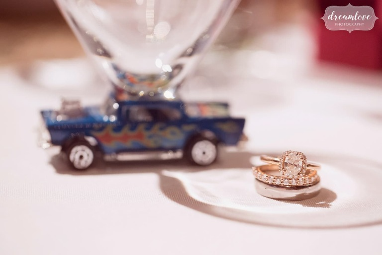The wedding rings are pictured at this antique car themed wedding at Larz Anderson.