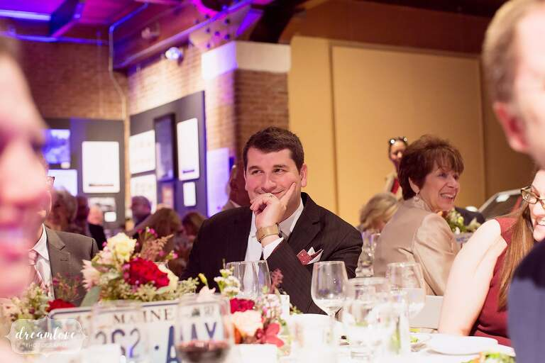 Guest smiling while watching speeches at Larz Anderson.