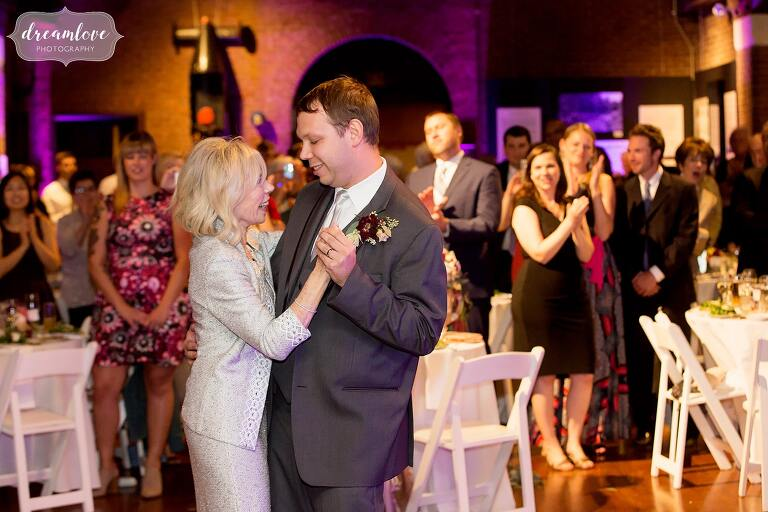 Sweet moment during the mother son dance at the Larz Anderson Auto Museum.