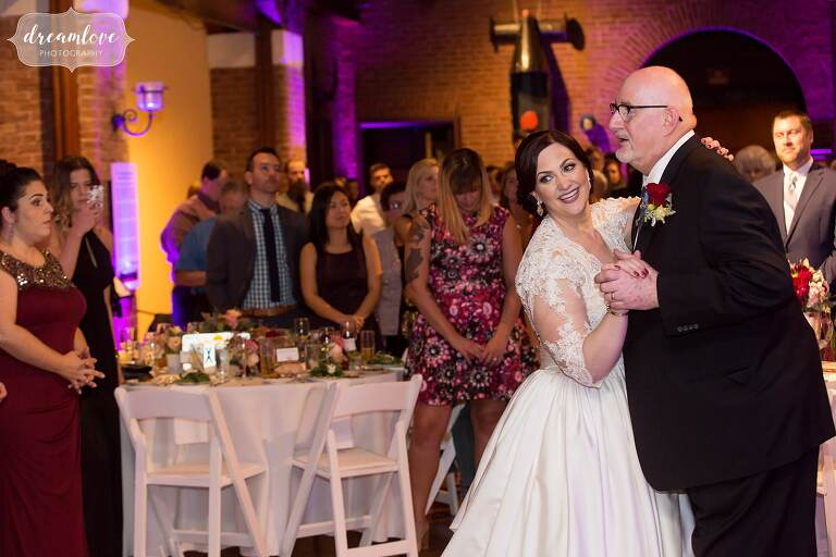 The bride dances with her father at the Larz Anderson wedding reception in October.