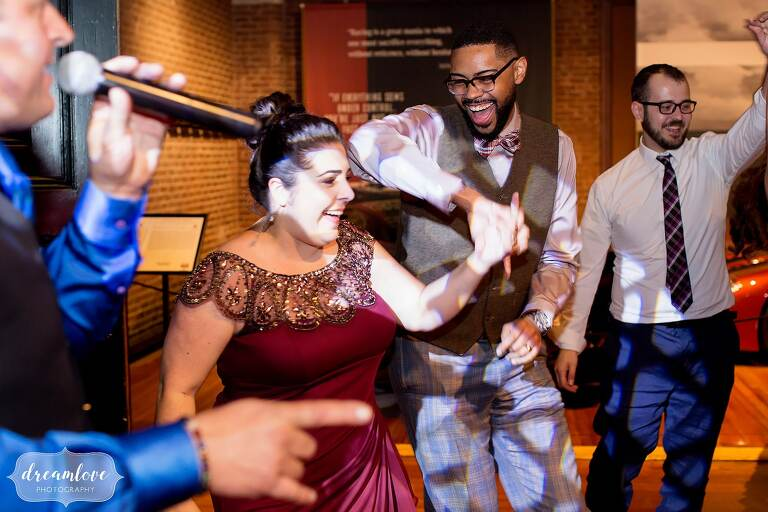 Funny bridesmaid dancing with her boyfriend while DJ's sings at Larz Anderson.
