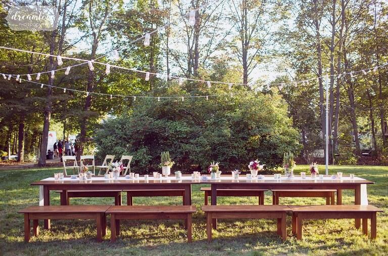 Romantic family style dinner table set up outside of Gould Barn for the rehearsal dinner.