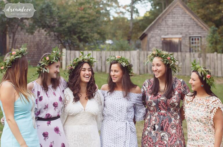 Bridesmaids wear flower crowns for this bohemian Gould Barn rehearsal dinner.