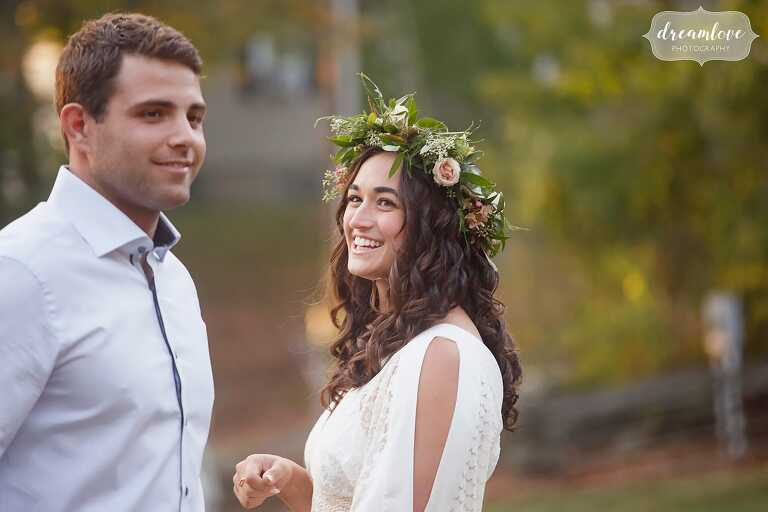 Candid photo of the bride to be smiling in her flower crown at this Gould Barn rehearsal dinner.