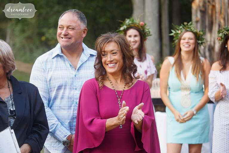 Candid photos of family during this relaxed rehearsal dinner at the Gould Barn.