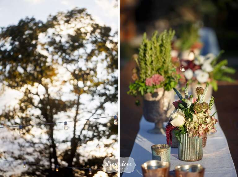 Earthy ceramic vases with herbs for this rustic rehearsal dinner table decor.