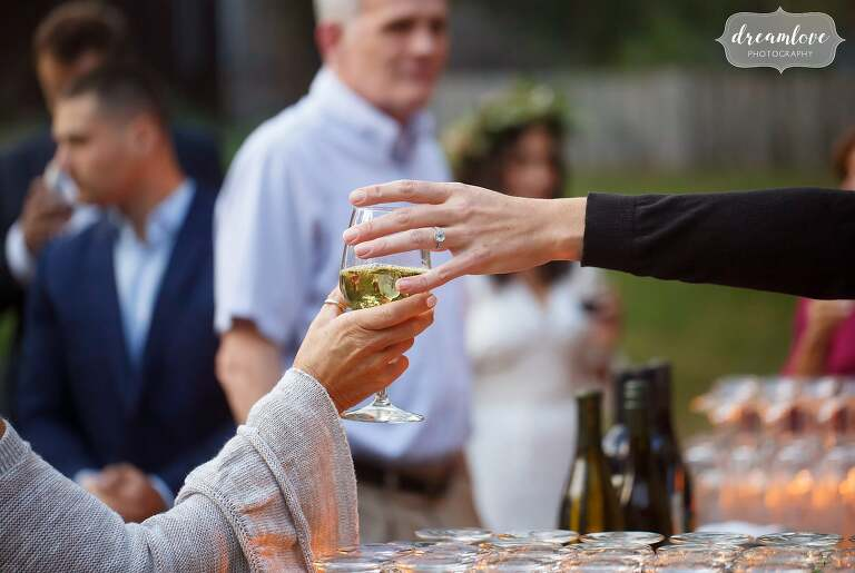 The bartender hands a guest a wine glass at the Gould Barn.