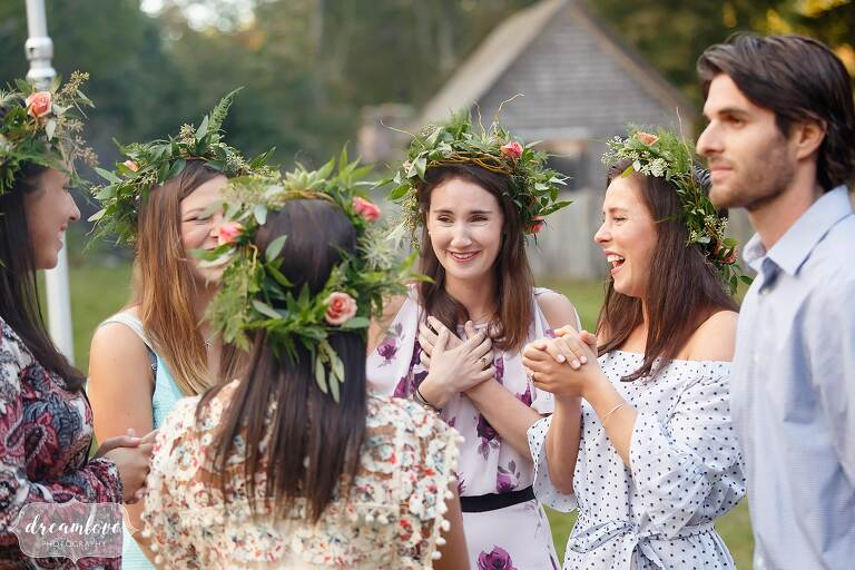 Girls wearing greenery flower crowns at this barn rehearsal dinner in Topsfield, MA.