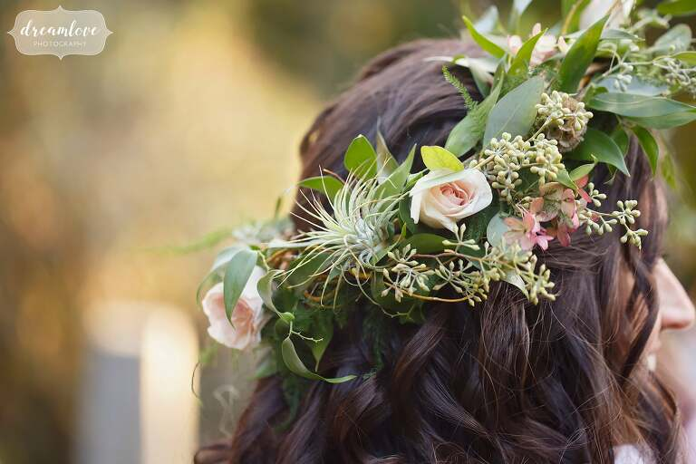 This romantic flower crown with air plants, eucalyptus and blush roses was fit for a fairytale at this rehearsal dinner.