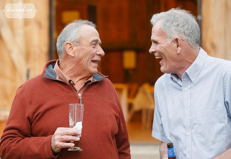 Great documentary photo of two older men laughing at Gould Barn.