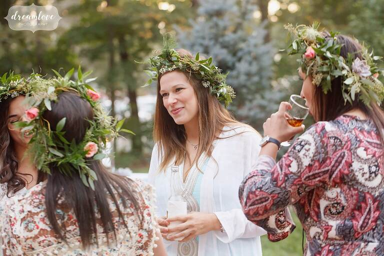 Bohemian bridesmaid in white vintage dress and flower crown.