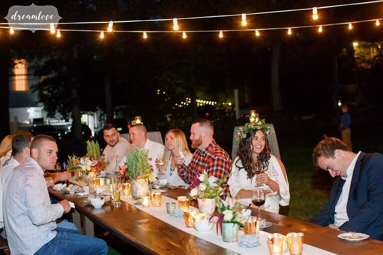 The bride to be enjoys her lobster dinner at this outdoor rehearsal at Gould Barn.