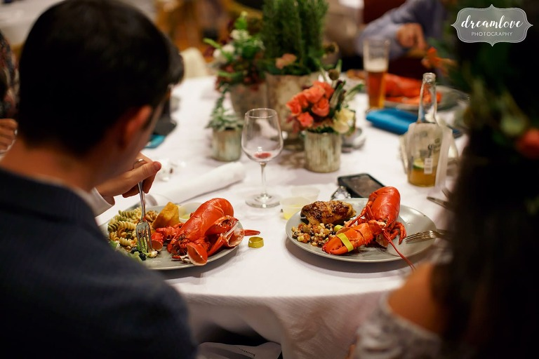 Guests at this Gould Barn rehearsal dinner enjoy steamed lobsters with their clambake dinner.