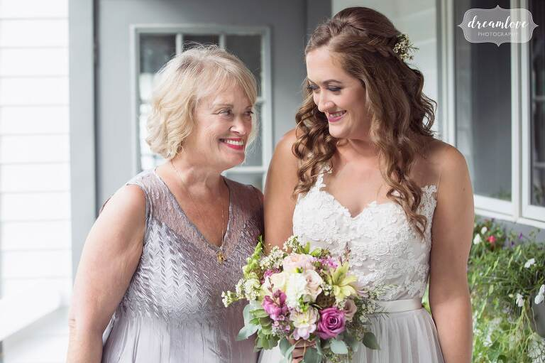 Sweet documentary photo of a mom and daughter before the wedding ceremony at the Warfield House Inn.