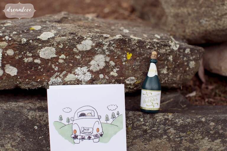 A tiny champagne bottle of bubbles to blow at the end of this outdoor ceremony in western MA.